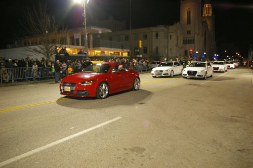 audi club oklahoma entered the tulsa christmas parade with a float of 8 white audis lined up as reindeer and complete with antlers being led by a
